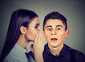 Latest rumors. Amazed man listening gossip in the ear