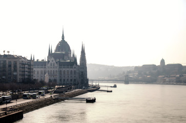 Backlight view of Hungarian Parliament next to Danube river in Budapest city