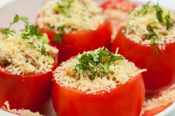 Stuffed tomatoes preparation : Raw stuffed tomatoes ready to be baked