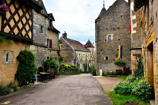 Picturesque street in a medieval village in Burgundy, France
