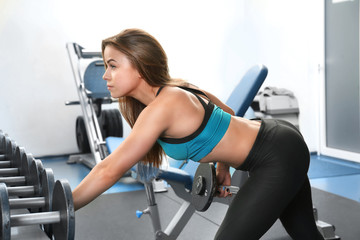 Young woman training in a gym
