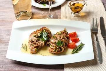 Tasty chicken marsala on plate