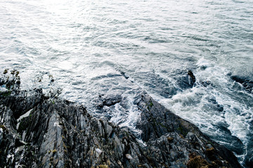 detail of water rushing over rocks in ireland
