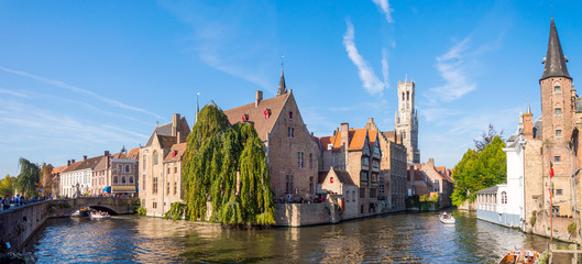 Wall Murals Bridges View from the Rozenhoedkaai in Brugge with the Perez de Malvenda house and Belfort van Brugge