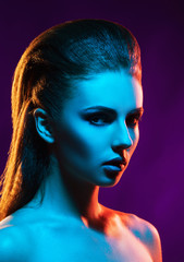 Portrait of a beautiful, seductive and young girl. Mixed and fashionable lightning effect.
