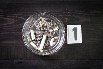 Cigarette butts in an ashtray for DNA analysis