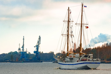 White sailing ship coming from Baltic sea and entering Riga