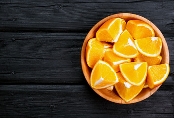 orange slices on a wooden background