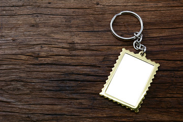 Metal key chain with space for text on wooden