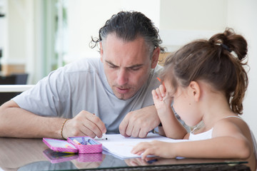 Dad and daughter draw together
