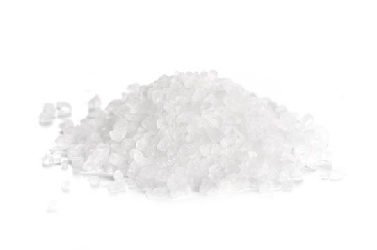 coarse sea salt on white background