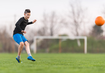 Kids soccer football - children player on soccer field