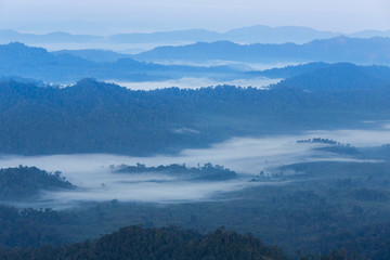 Foto op Plexiglas Heuvel High angle view over tropical mountains with white fog in early morning in Thailand.