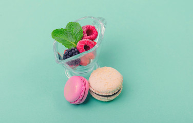 Delicious dessert with mint, macaroons and fresh fruit in a glass jar
