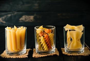 closeup spaghetti in cup black wood