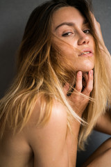 Sensual woman touching chin