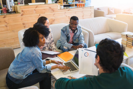 Happy young multiracial group of young university students studying