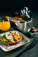 Brunch with coffee, orange juice and toast with avocado and boiled egg