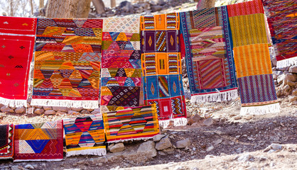 Handmade traditional in vibrant colors berber rugs hanged on line