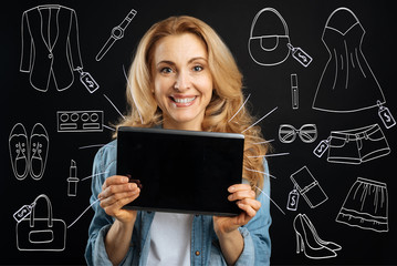 Happy nice woman doing shopping online