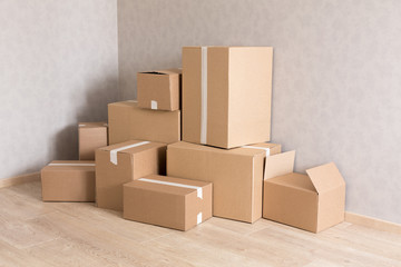 Moving boxes pile in new empty room