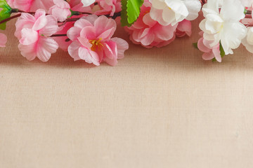 Frame of spring flowers on a wooden ,with space for text ,spring or summer theme
