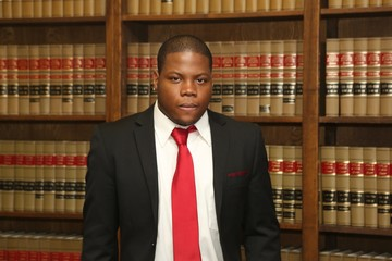 Young African American Lawyer in Law Library