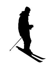 Silhouette of man on alpine skiing