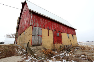 An old red barn in the snow in Illinois