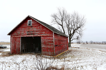 A beautiful old red barn in the snow in Illinois
