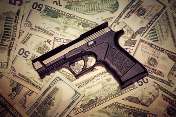 handgun and money grungy