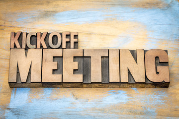 Kickoff meeting word abstract in wood type