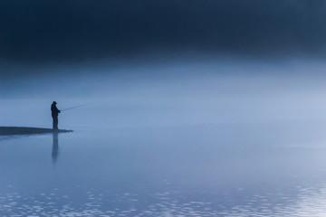 Silhouette fisherman