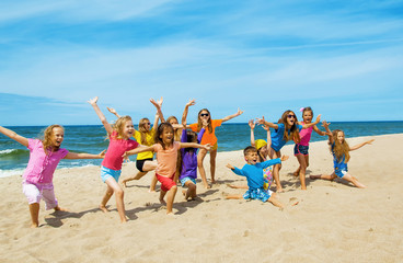 Active happy children on the beach