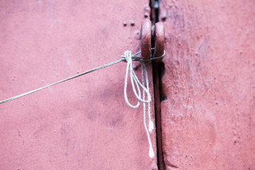 pully and string on pink wall