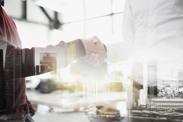 businessmen making handshake at office