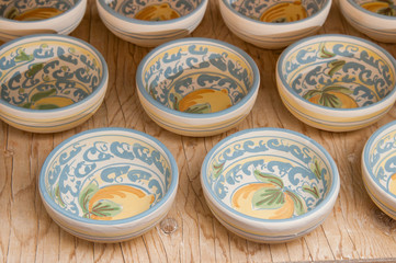 Closeup view of some decorated ceramic bowls in a workshop of Caltagirone, Sicily