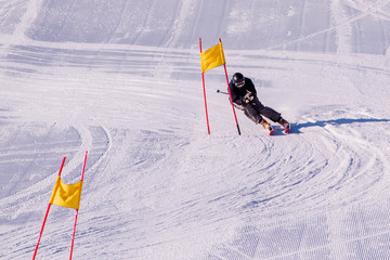 People are enjoying downhill skiing and snowboarding