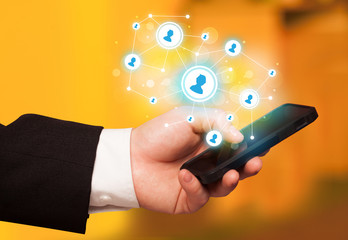 Finger pointing on smartphone, social network concept