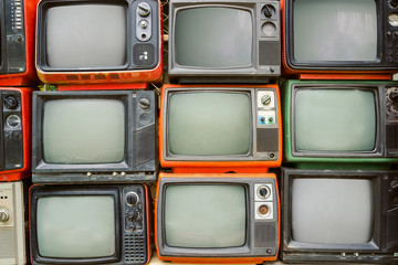 antique and vintage style photo retro televisions pile on floor in