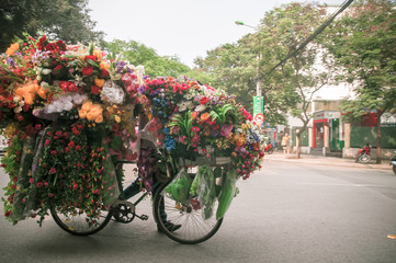bicycle with flowers for sale on Hanoi Street, North Vietnam
