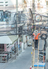 an electrical lineman working on a line