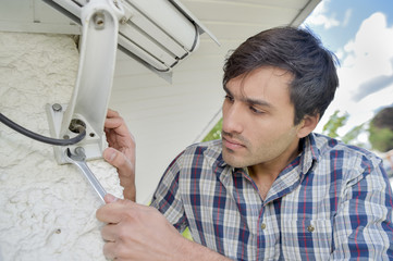 Cautious man installing a security camera
