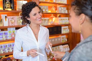 Woman sampling perfumes