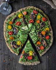 Overhead view of pesto pizza on table