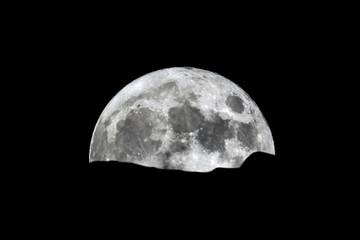 Full moon rising over the horizon