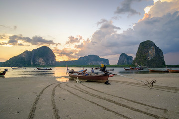 small fishing boat on the ground after ebb tide, Pakmeng bay, Thailand