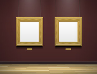 two golden blank picture frames in art gallery museum
