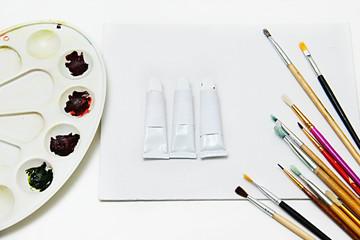 Paint brush or brush of art. Model of tubes for paints. Tubes for oil paints mock up
