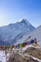 Fotobehang Nepal Prayer flags and snow mountain of Himalaya Annapurna base camp, Nepal